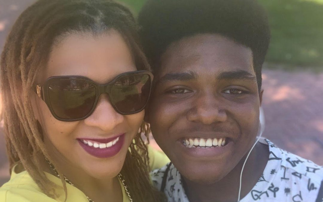 UCW Senior Stephon Roberts poses with Chief Alumni Officer Candace Jones for a photo at Pioneer Prep.