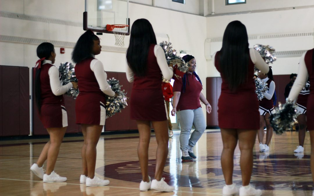 UCW cheerleaders celebrate their fellow classmate who has just been accepted to college!